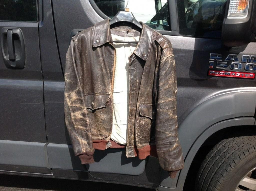WWII LEATHER BOMBER JACKET, AGE WORN TO THE LEATHER AS
