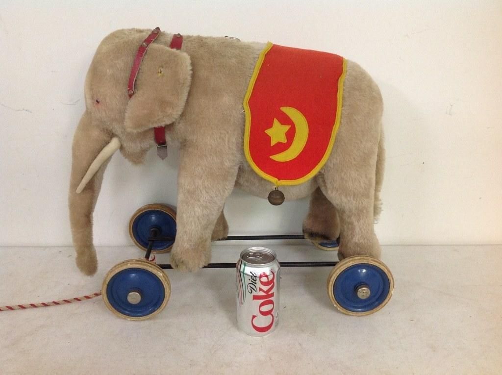 LARGE STEIFF ELEPHANT ON WHEELS, BUTTON IN EAR,
