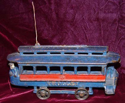 8C: Harris Toy Co. Toledo Trolley Car Toy 2 conductors