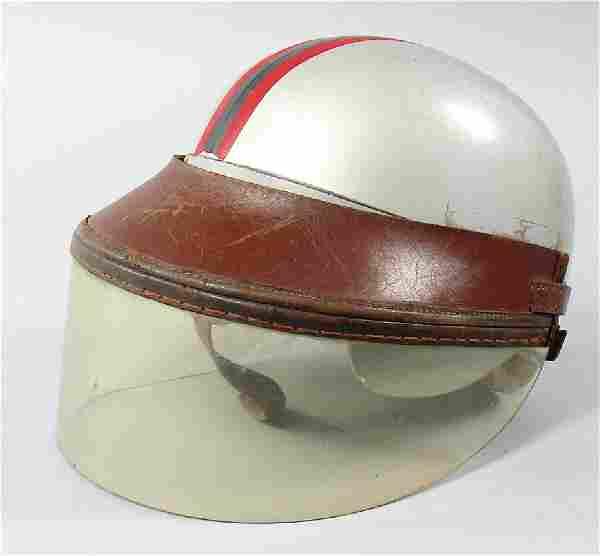 '50s/'60s, crash helmet probably Johnnie Herbert with