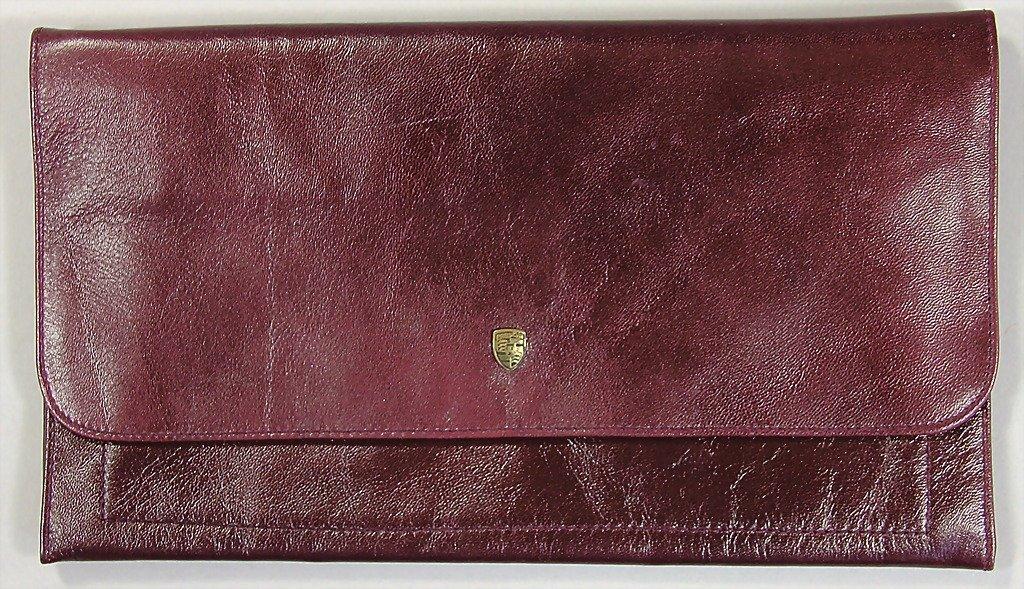 1502: PORSCHE, c. '80s, wine-red leather bag with Porsc