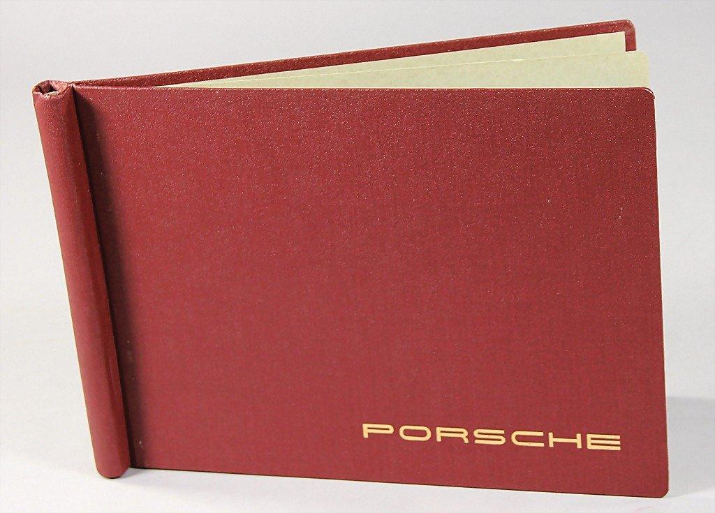 1526: PORSCHE, wine-red Porsche folder with signature,