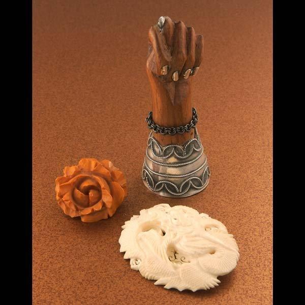 5: Vintage jewelry. One carved bone or ivory brooch of