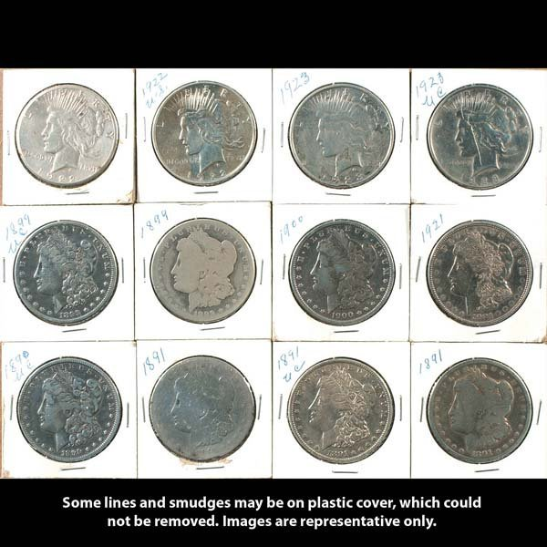 11: Twelve collectible silver dollars. Eight are Morgan