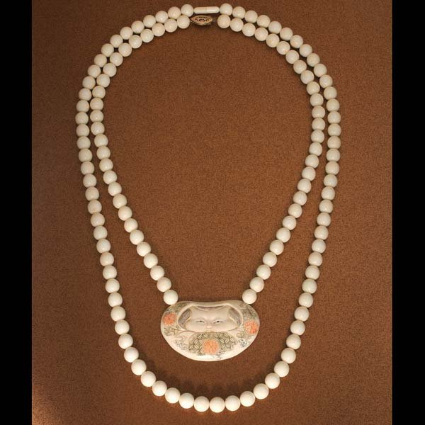 17: Ivory beaded necklaces. One with ivory barrel clasp