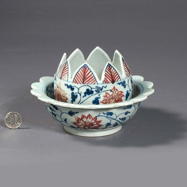 8: Antique Chinese porcelain bowl with lotus design.