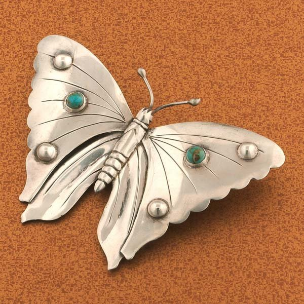 13: Mexican silver butterfly brooch with two turquoise