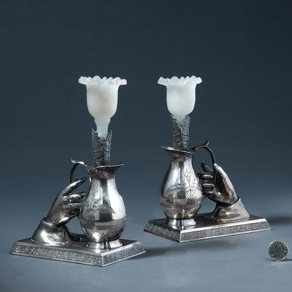 19: A pair of Wilcox silver plate candlesticks with lad