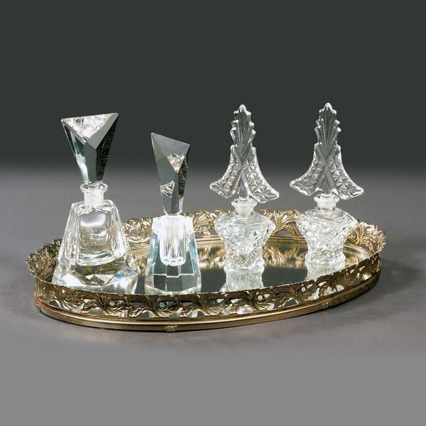 8: Glass perfume bottles with stoppers. Oval mirrored