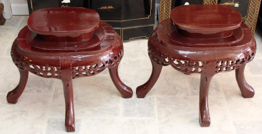"Pair of Asian wood carved oval stands; 22"" x 20"""