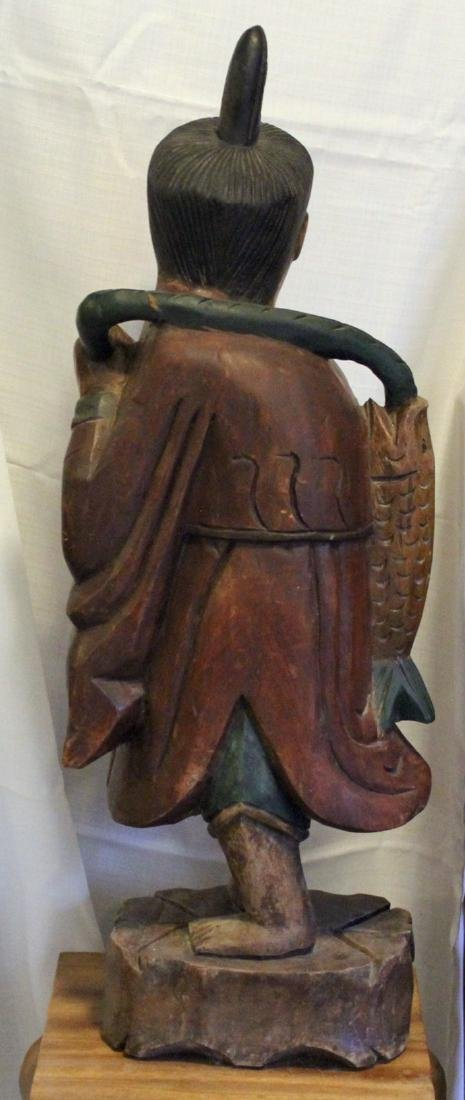 "Asian wood carved fisherman, 11"" x 31"" - 5"