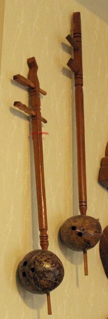 """2 traditional 2 string Chinese instruments; 4"""" x 25"""" & - 2"""