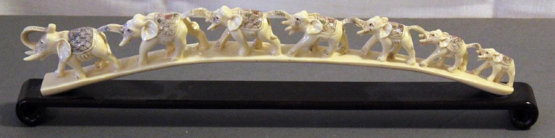 "elephant bridge of 7 graduated elephants; 17.5"" x 4.5"""