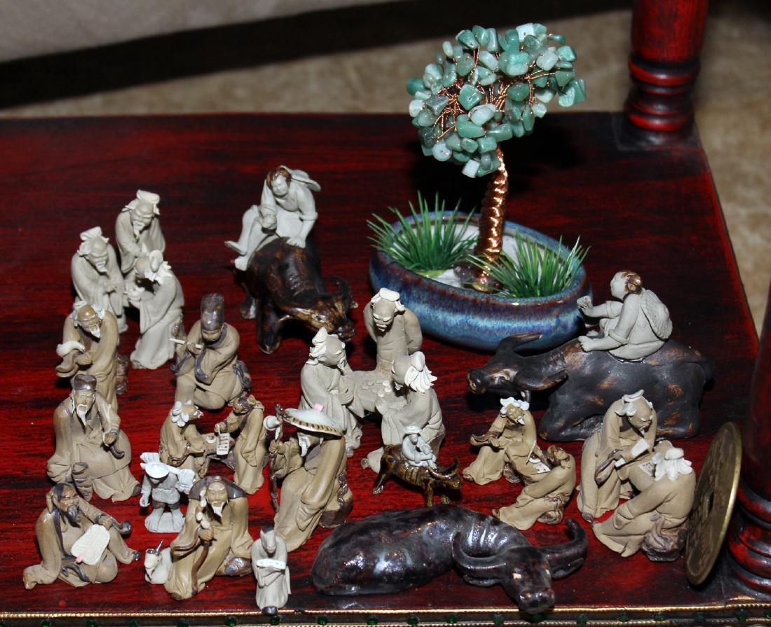 (17) clay figures wisemen gaming, drinking, playing