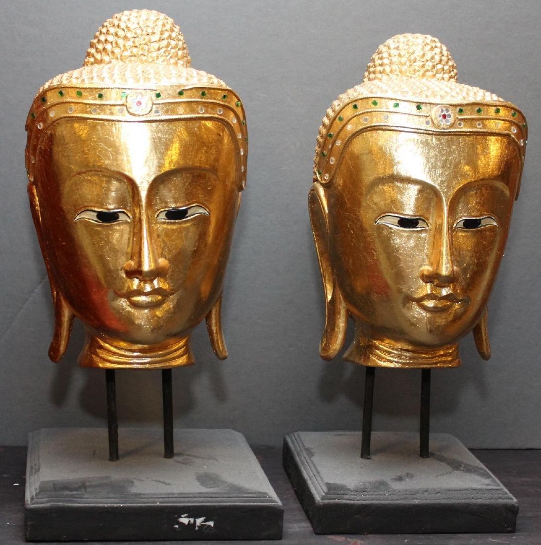 "Pair Thai gilt wood Buddha heads on stands; 8"" x 17"""