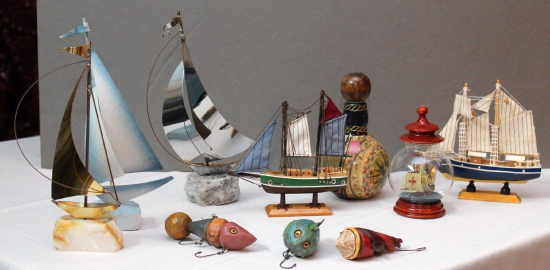 5 sailboat models; ship in a ball, 3 newly carved