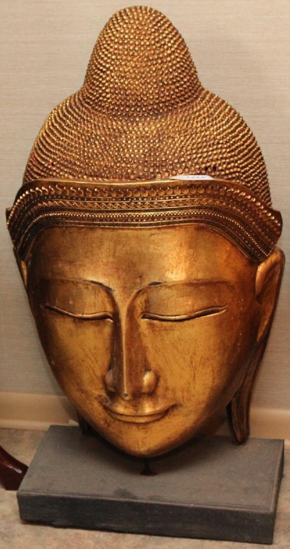 "Thai wood carved gilt decorated Buddha head; 21"" x"