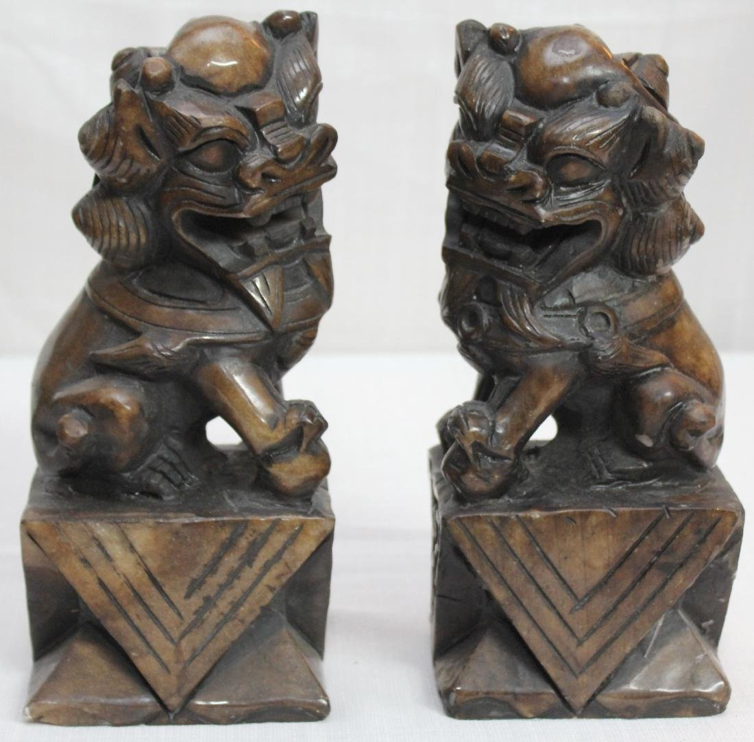 "pair carved brown hardstone Temple dogs; 4.75"" x 11"""