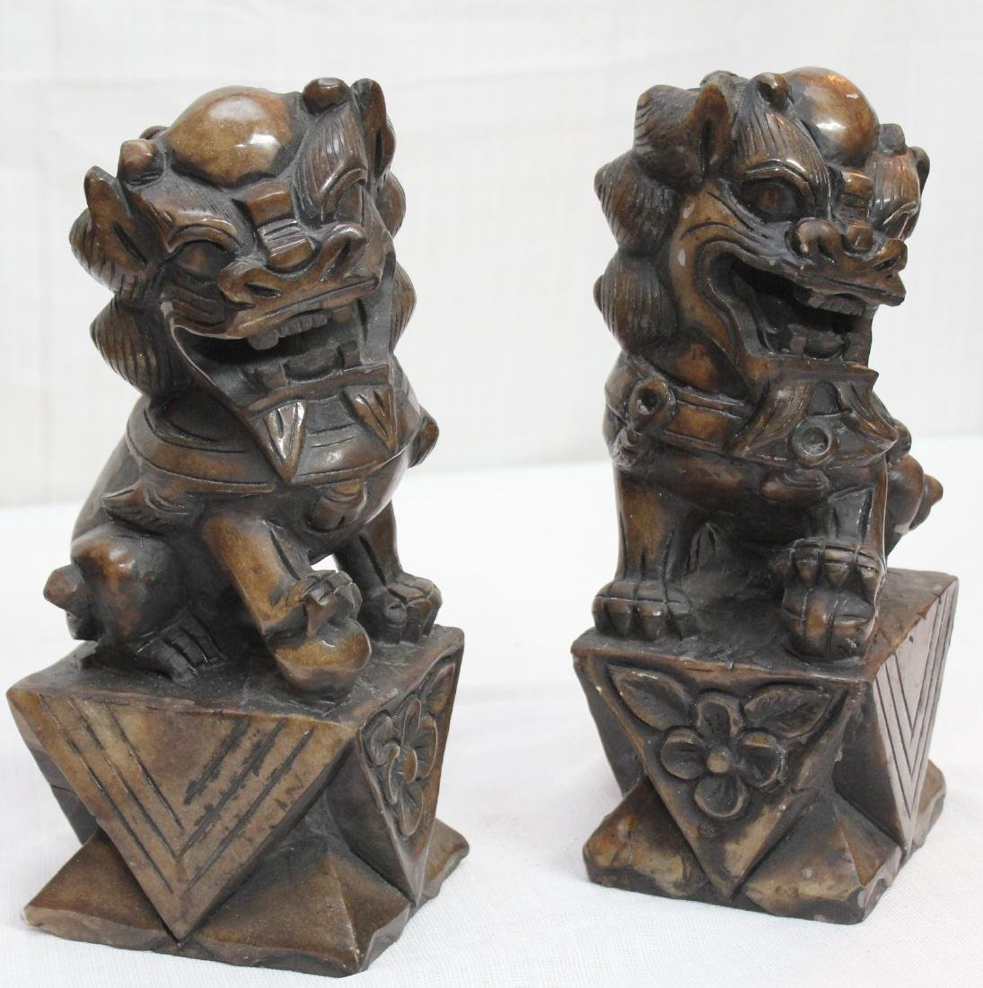 "pair carved brown hardstone Temple dogs; 4.75"" x 11"" - 2"