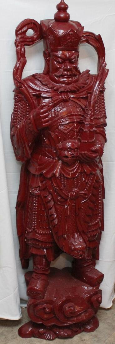 Chinese wd carved wiseman in red, showing few light