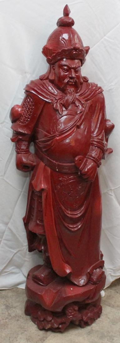 Chinese carved wdn warrior in red showing few light