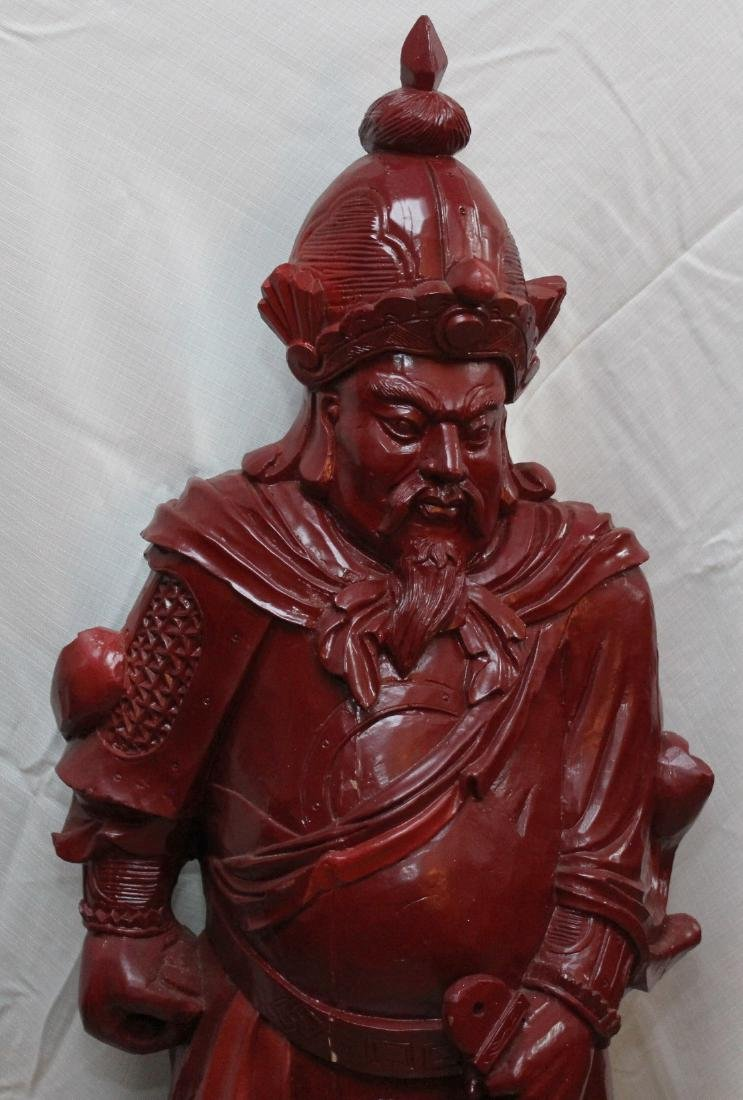 Chinese carved wdn warrior in red showing few light - 2