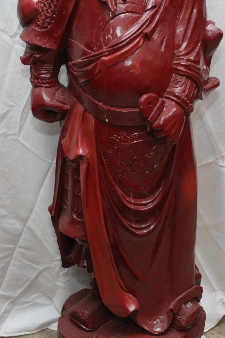Chinese carved wdn warrior in red showing few light - 3