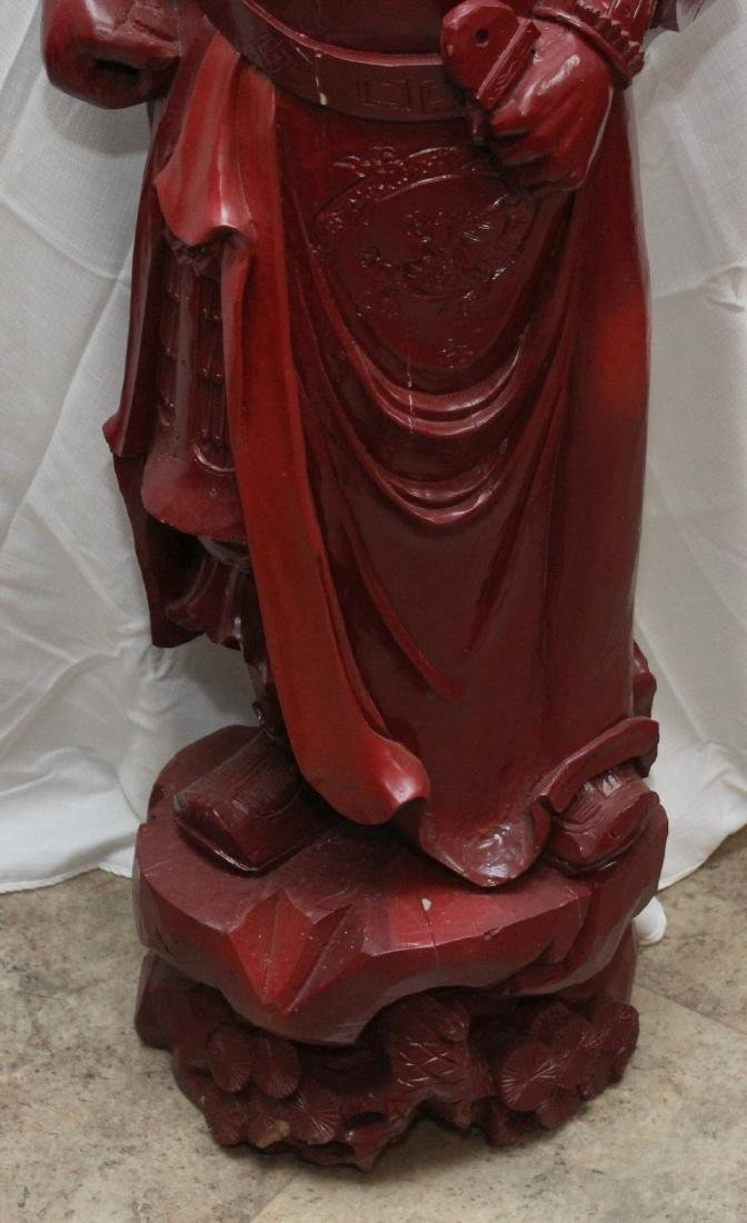Chinese carved wdn warrior in red showing few light - 4