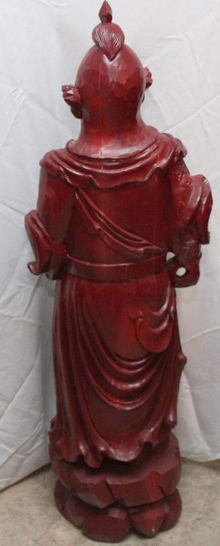 Chinese carved wdn warrior in red showing few light - 5
