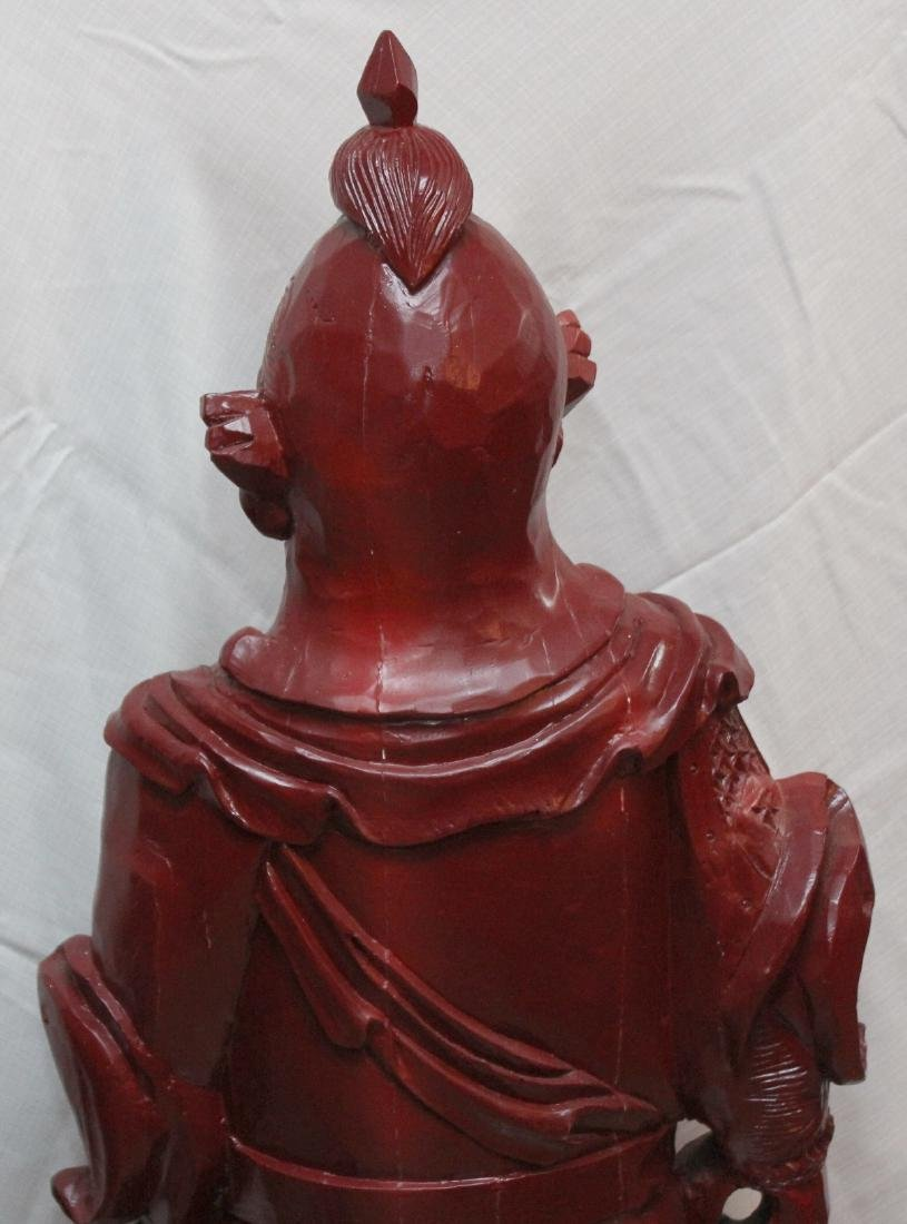 Chinese carved wdn warrior in red showing few light - 6