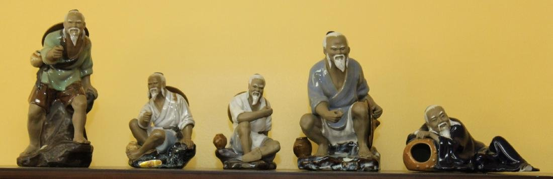 Set of 5 glazed clay Chinese figures of fisherman etc.