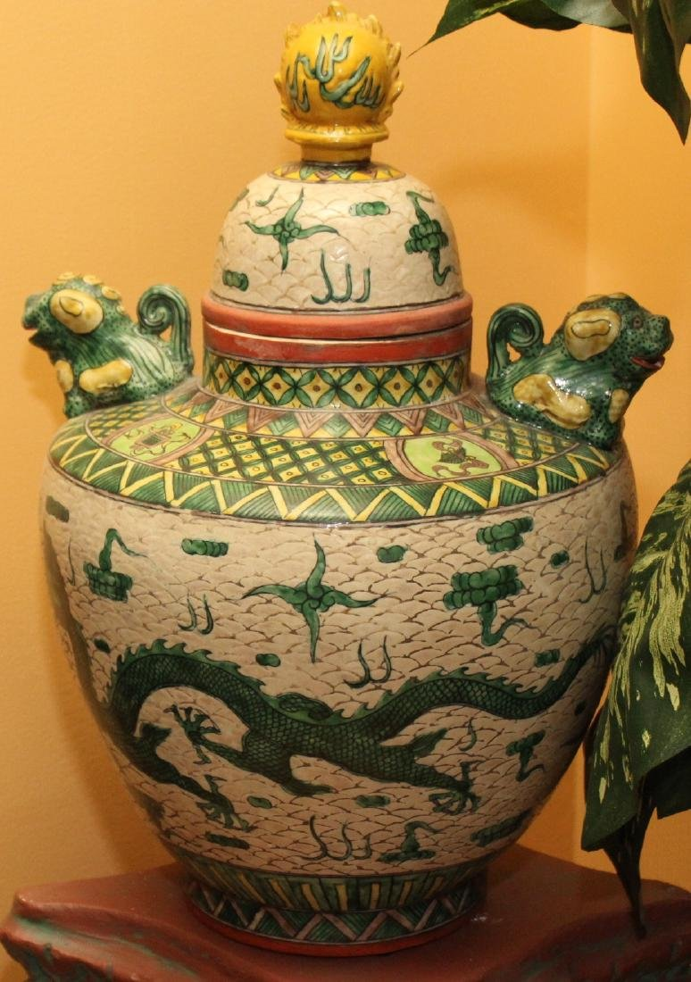 Chinese porcelain glazed lidded vessel having temple