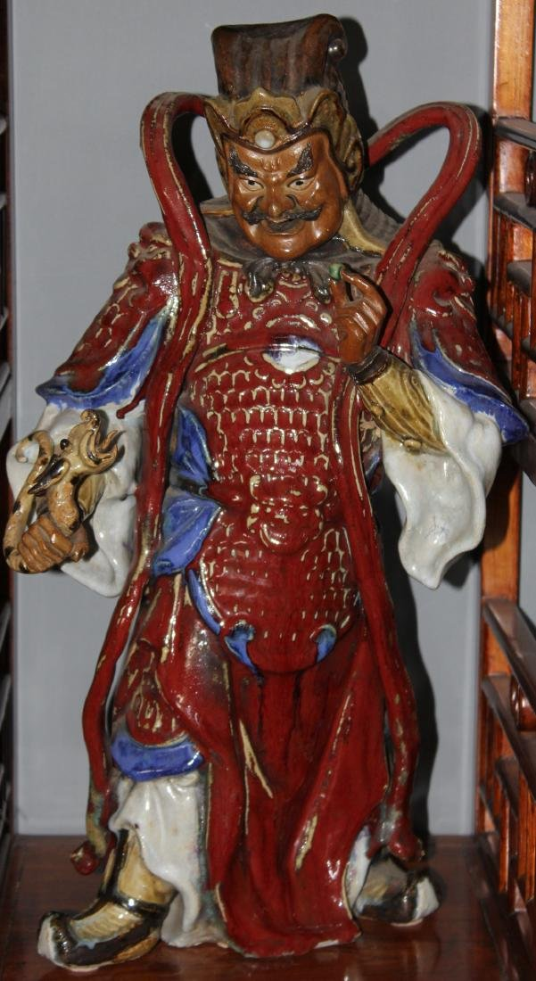 Two Chinese ceramic red glazed guardian figures, modern;