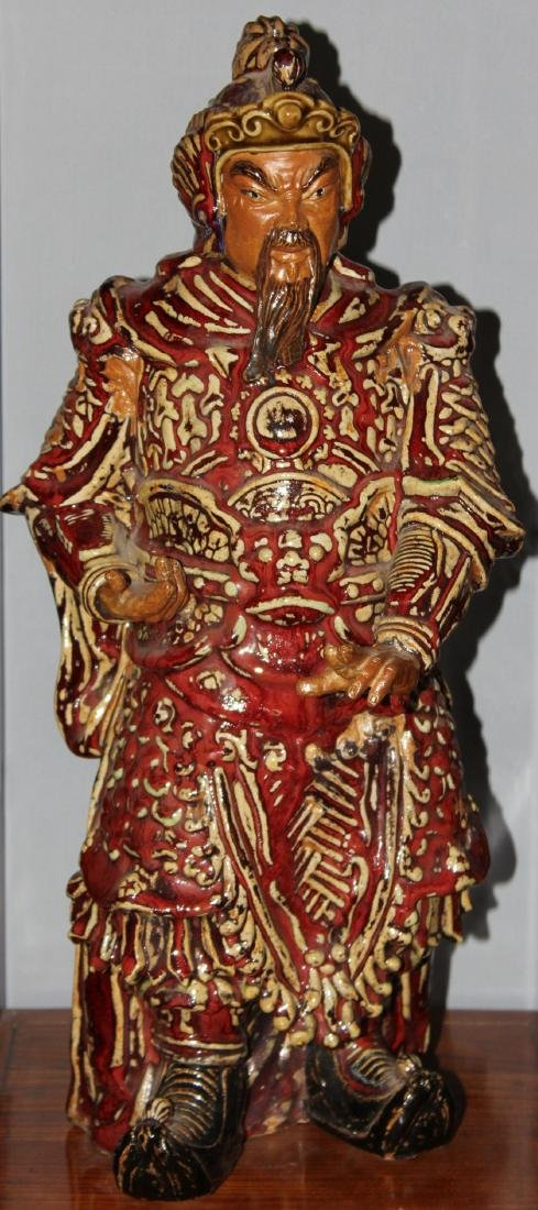 Two Chinese ceramic red glazed guardian figures, modern; - 2