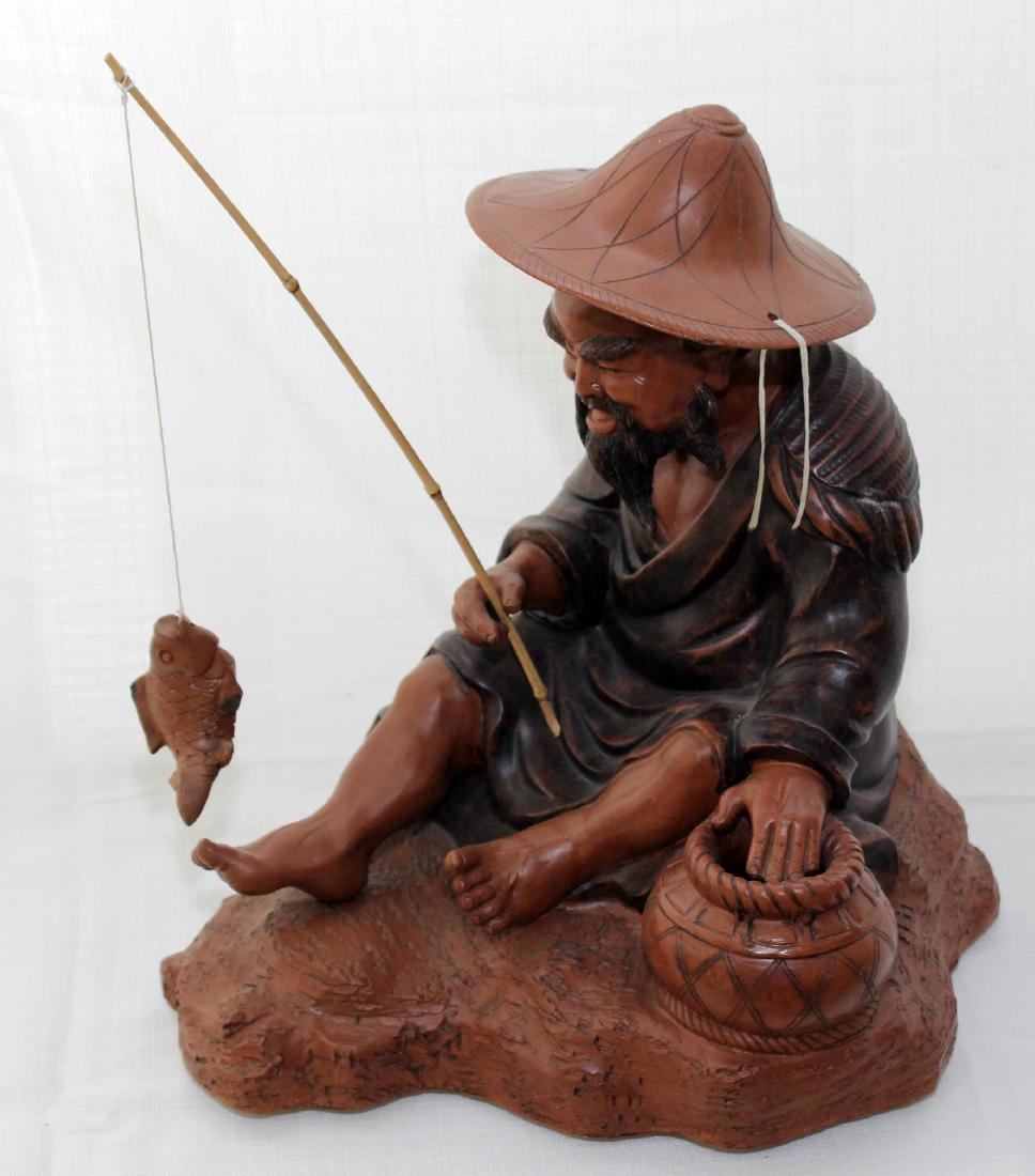 """Chinese clay statue of man fishing 16"""" x 13"""""""