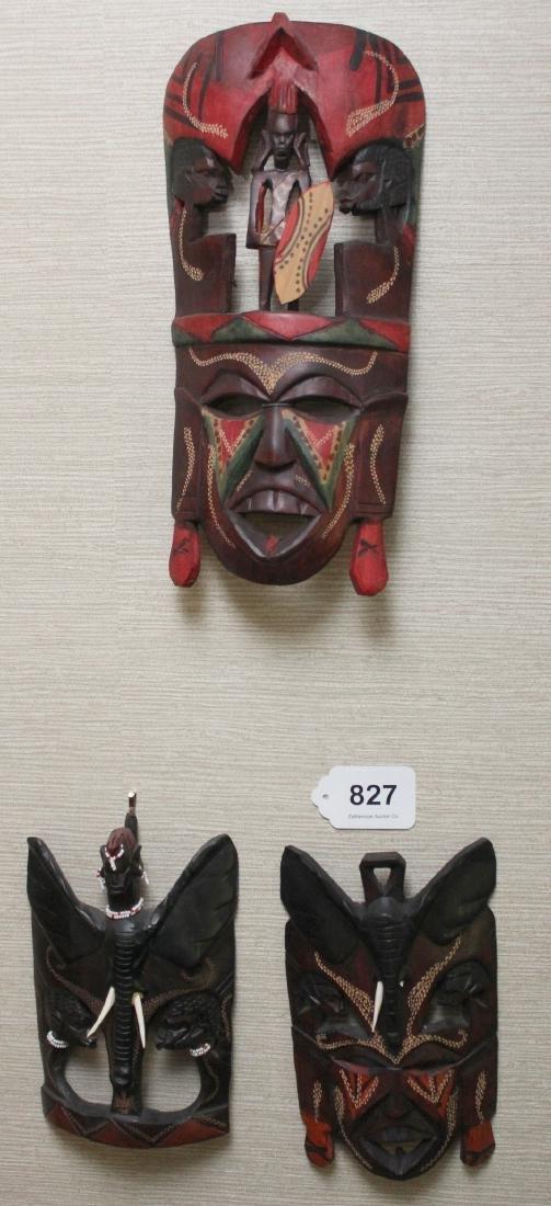 (3) Kenya carved wood masks depicting scenes of