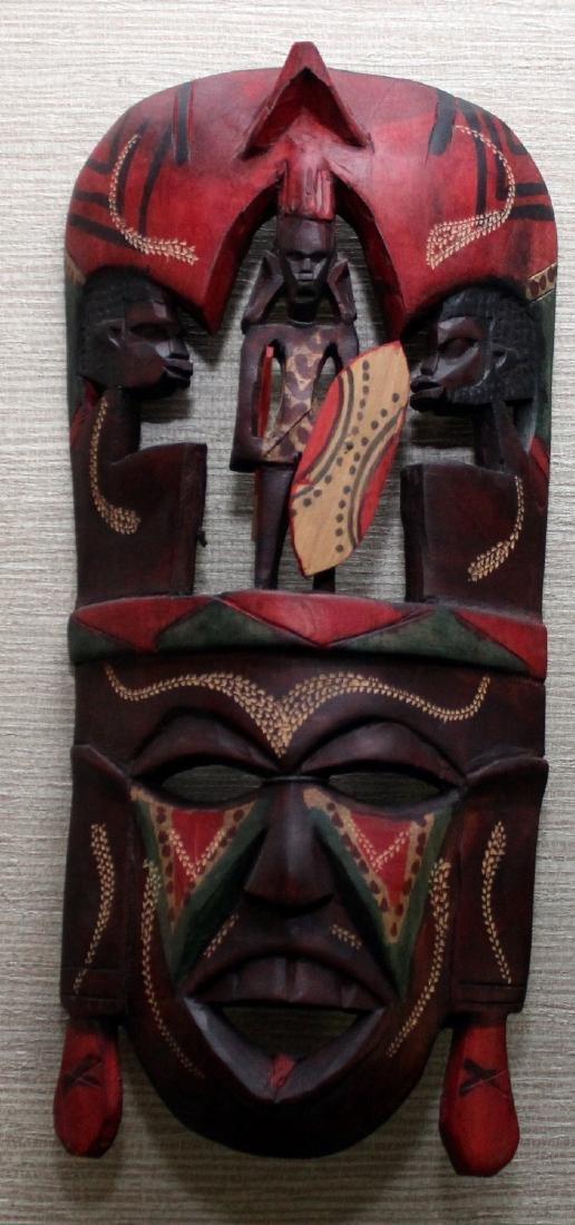 (3) Kenya carved wood masks depicting scenes of - 2
