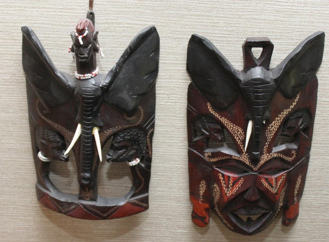 (3) Kenya carved wood masks depicting scenes of - 4