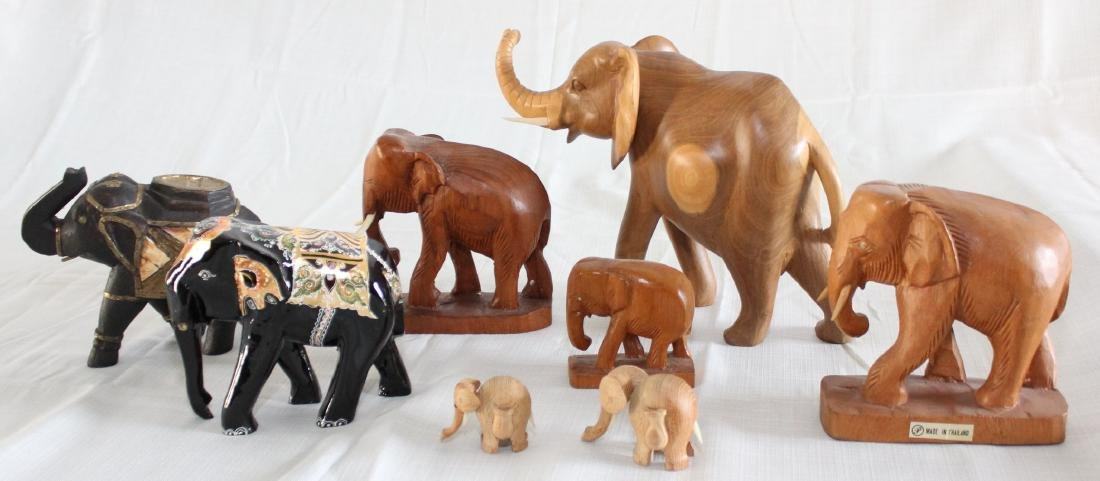 Grouping of 8 wood carved elephants, 1 paint deco
