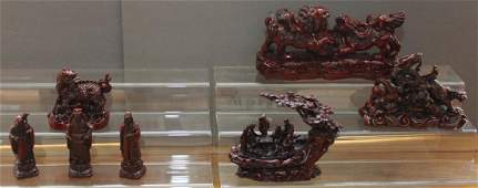 grouping of 7 Chinese cast resin red lacquer figurines