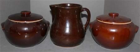 3 pcs.- brown glazed stoneware pitcher; (2) brown