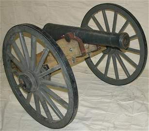 697: Cannon on wooden carriage