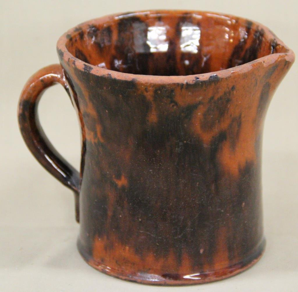 redware pitcher with Manganese spotting