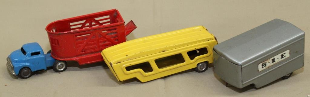 50's tin miniature truck tractor- 3 trailers;