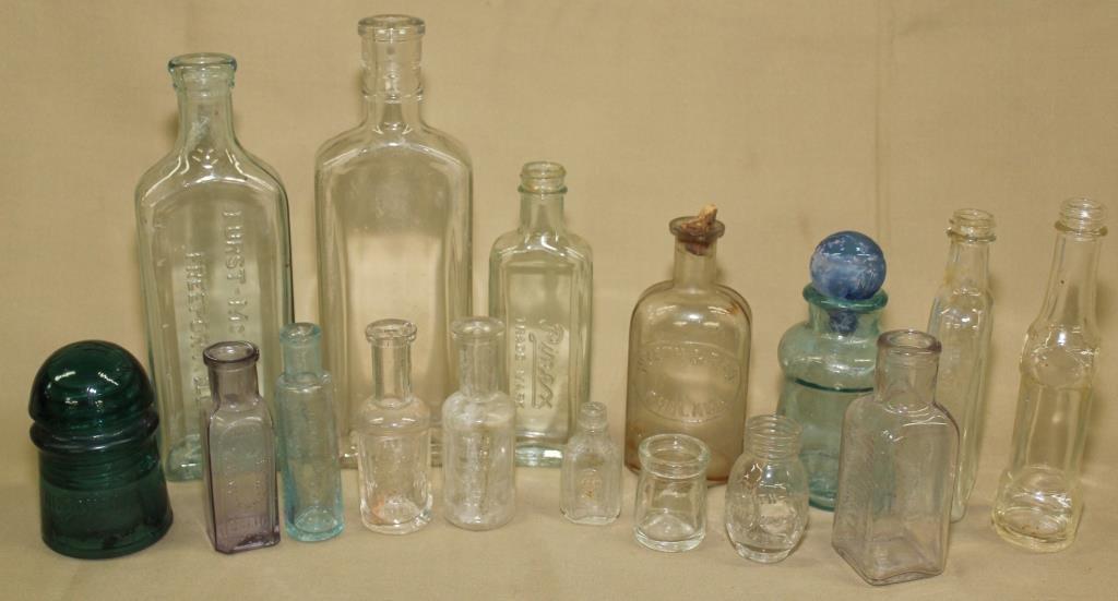 15 bottles and glass insulator
