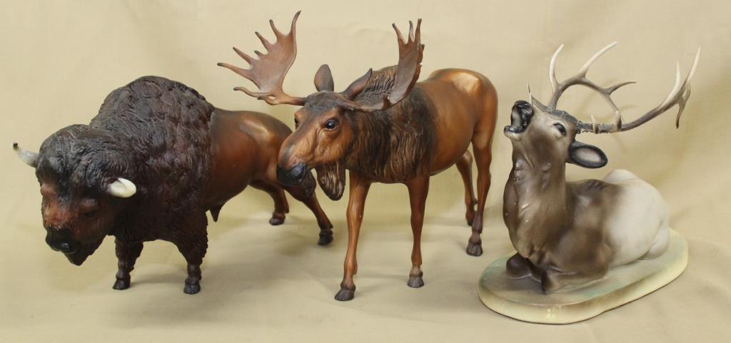 "cast plaster elk 10"" long, plastic moose 12"" long,"