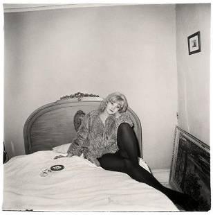 70B: DIANE ARBUS (1923-1971); Girl in Coat Lying on her