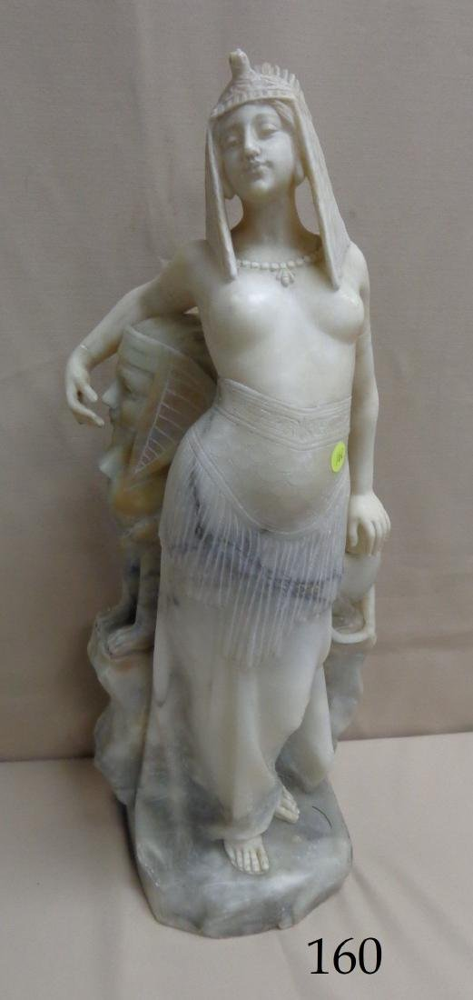 CARVED MARBLE SCULPTURE OF AN EGYPTIAN