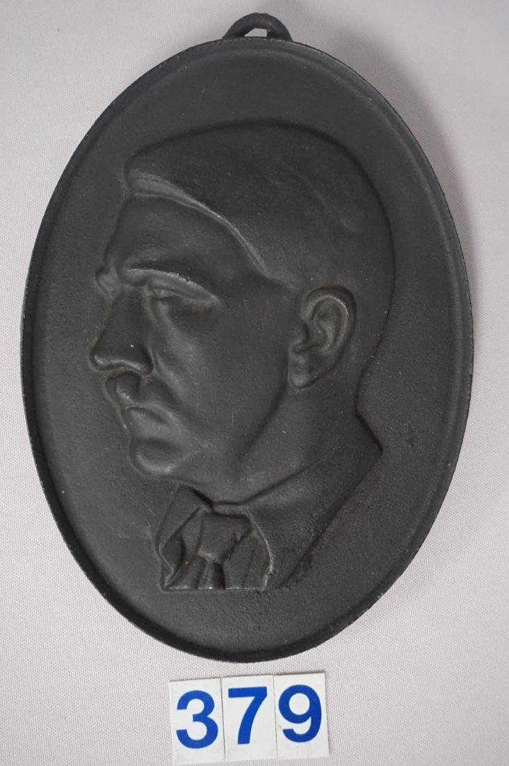 OVAL CAST IRON PLAQUE WITH EMBOSSED
