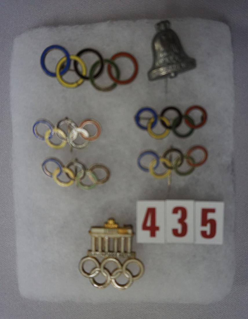 SMALL DISPLAY CASE WITH (7) OLYMPIC
